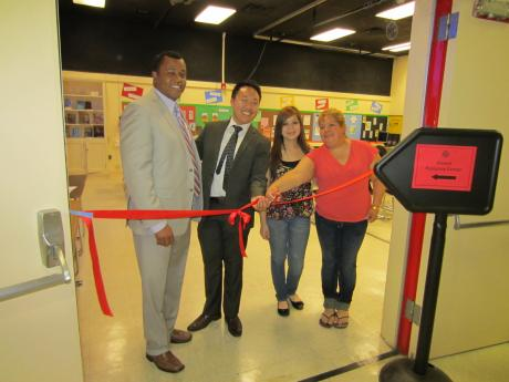 Principal Peter Lambert, CKM Parent Advisor Johnny Vue, Elsy Toriz-Arellano and Ana Arellano cut the ribbon to officially open the Parent Resource Center