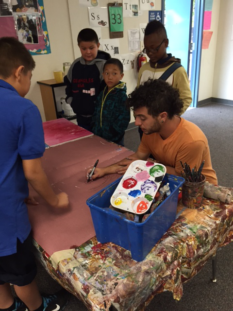 Common Vision staff paints with students