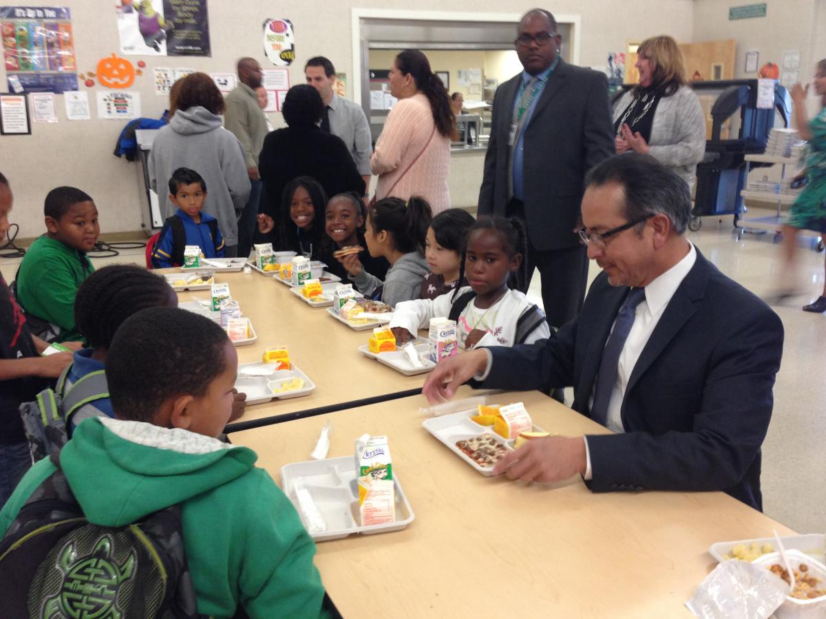 Superintendent Banda with John Still K-8 students