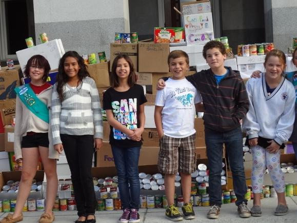 Leonardo da Vinci K-8 School students connect with their community through service, including a canned goods drive.
