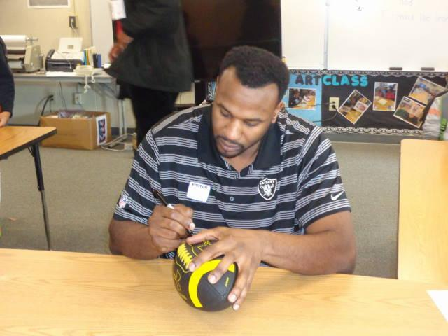 Image of Former Raiders linebacker visits Harkness Elementary