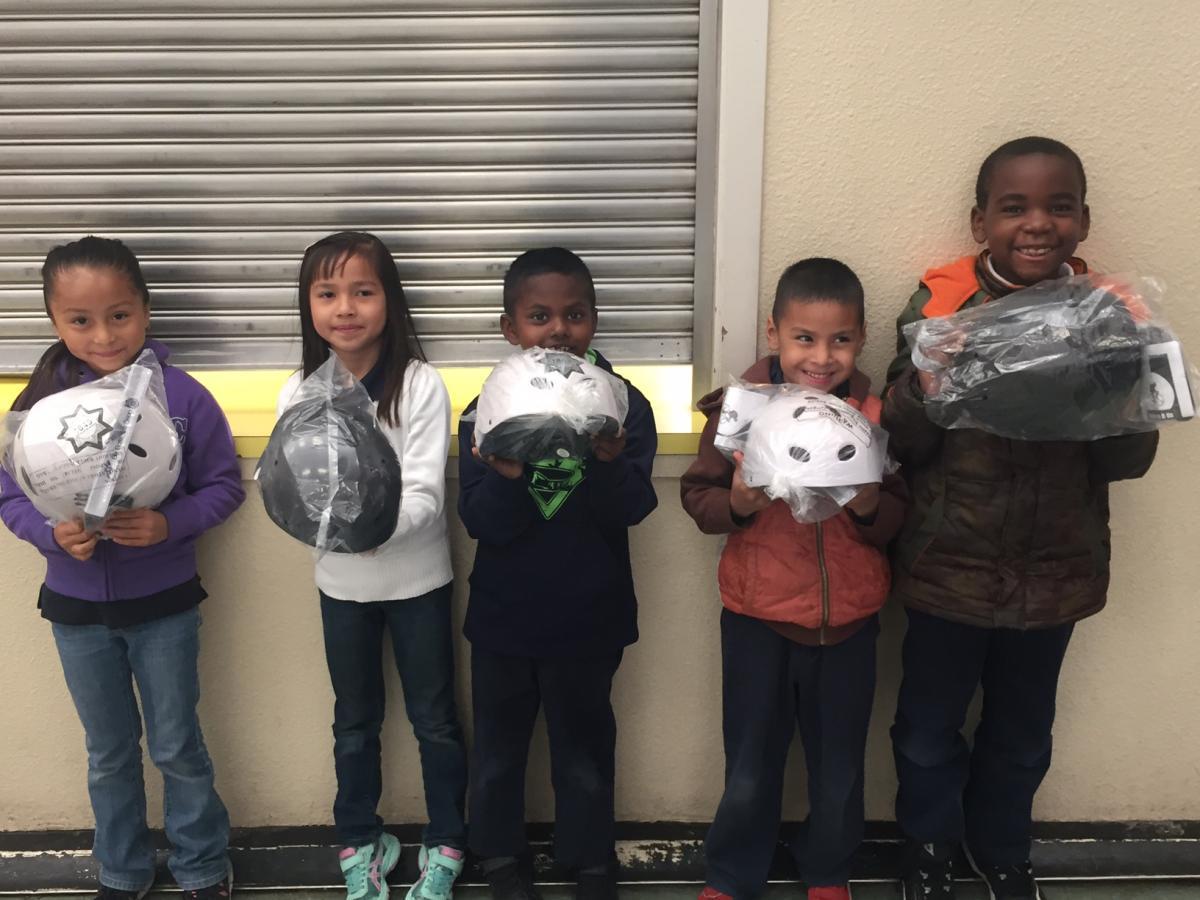 Image of Earl Warren students get free bike helmets
