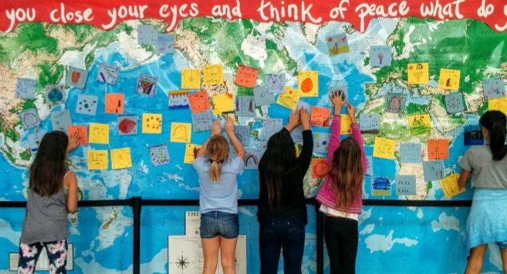 Image of Caleb Greenwood IB students create Peace Wall, partner with Sac State