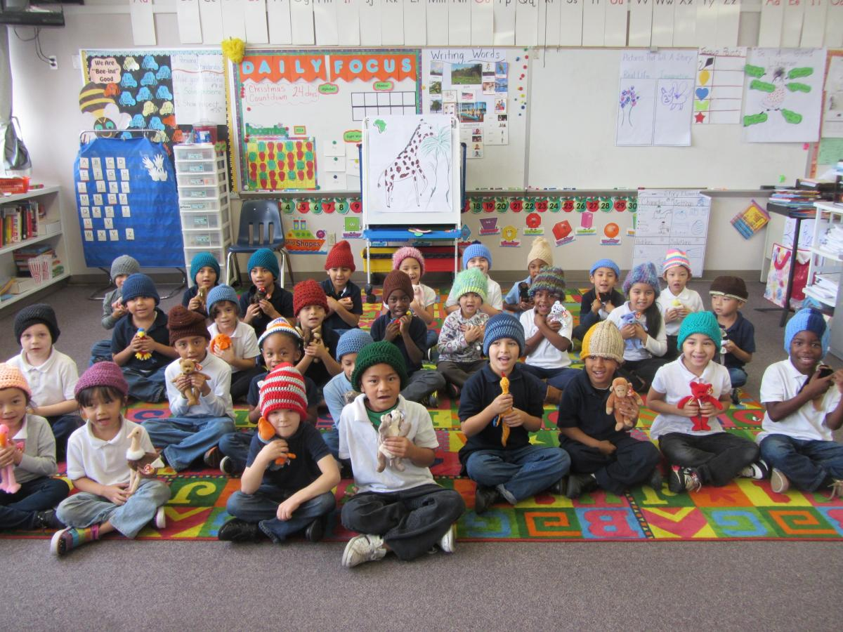 Image of Primary students receive knit caps and 'reading buddies'