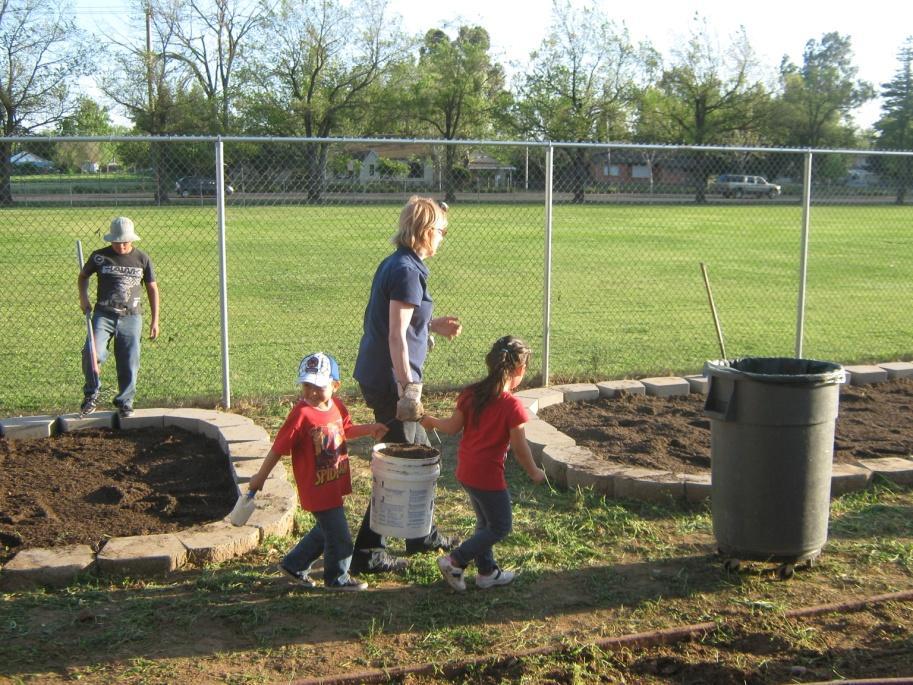 Image of Earl Warren community helps prepare garden for planting