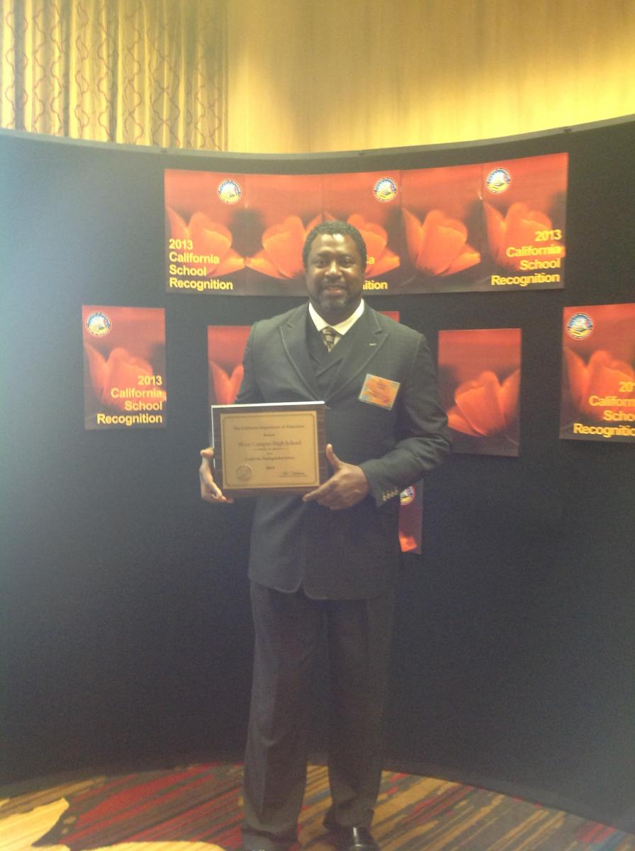 Image of West Campus principal accepts Distinguished School Award