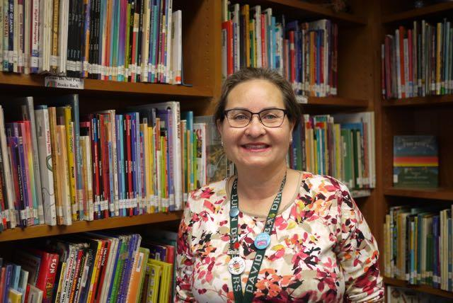 Image of Librarian helps students develop literacy skills