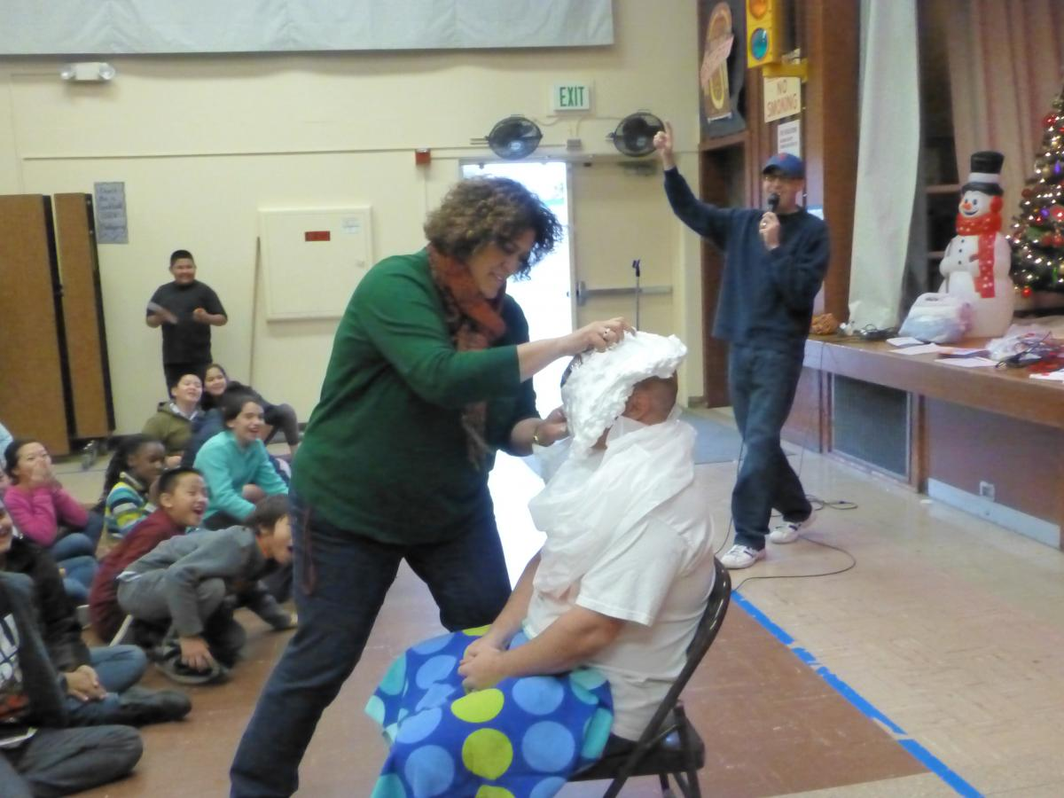 Image of Nicholas Elementary teacher takes a pie in the face — for a good cause