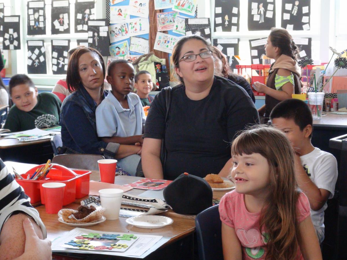 Image of Mom's delight in kids' videos at Oak Ridge