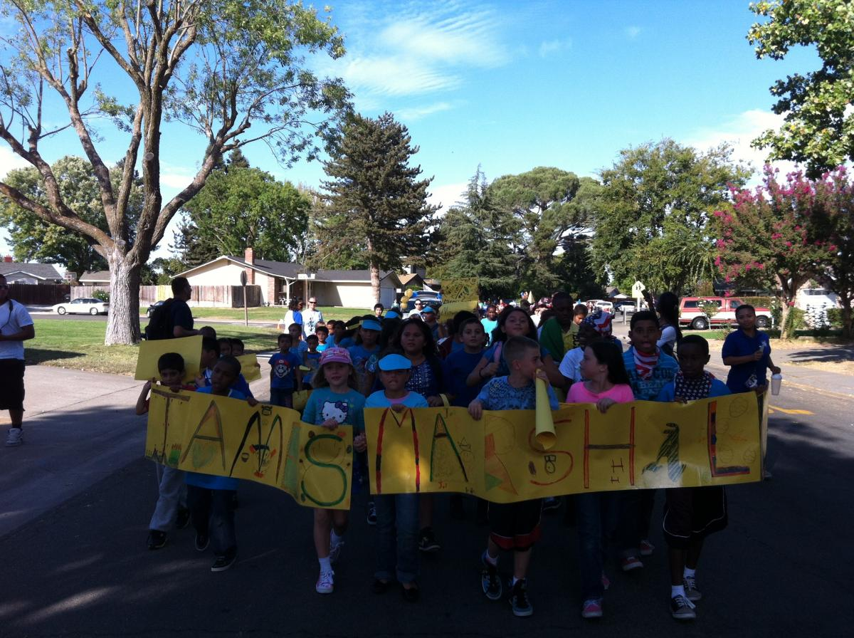 Image of James Marshall kids turn out for Rosemont's homecoming parade