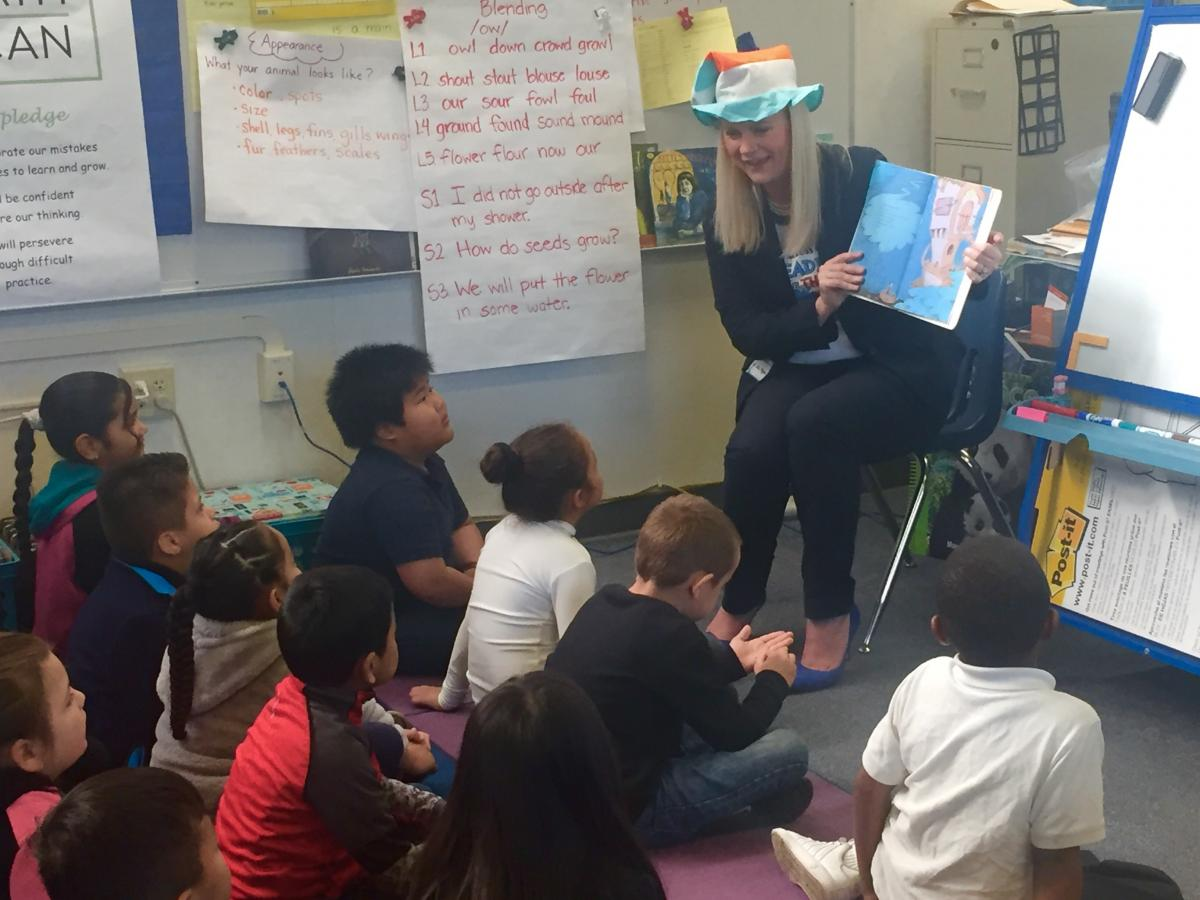 Board member Ryan reads to Pacific Elementary students